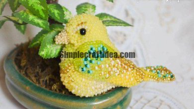 Budgie of felt and beads