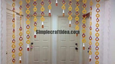 Curtain made from milk bottle rings ,cardboard and jelly cups