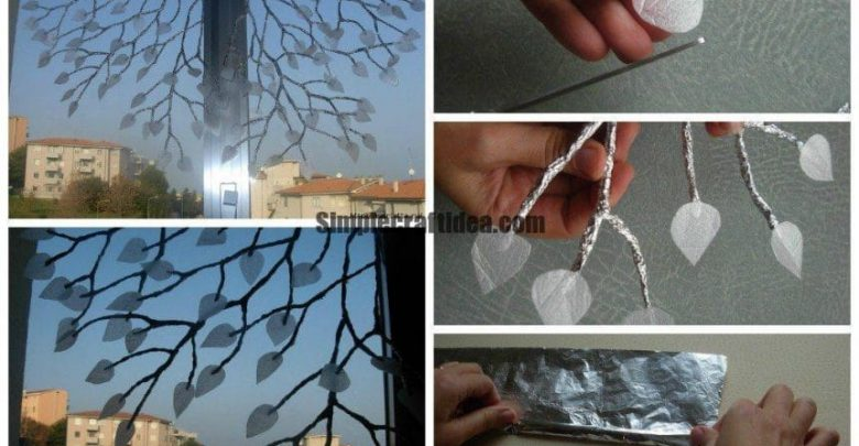 Decoration of windows silver foil branches