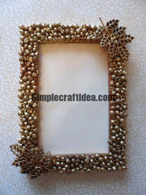 Photo frame decorated with peas, barley and curly pasta