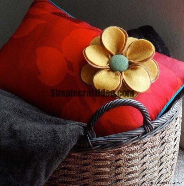 Beautiful cushion with flowers made of felt