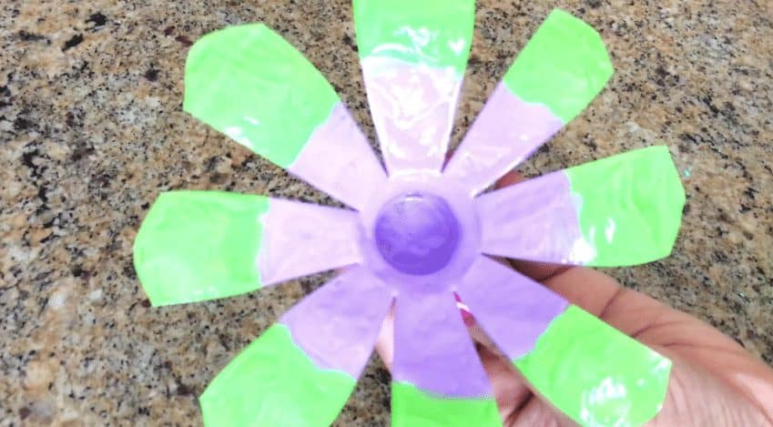 Plastic water bottle flowers with pop sticks decor