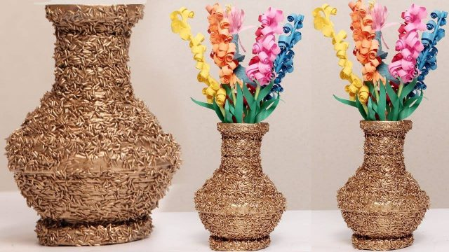 vase from a newspaper and rice