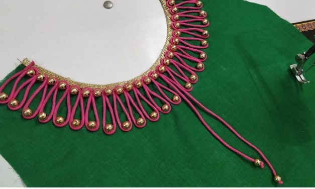 Very creative beaded boat neck design for kurti