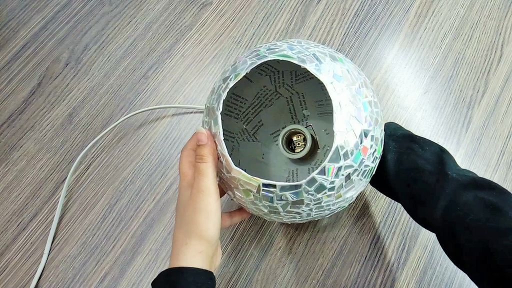 Lamp With Paper and CDs