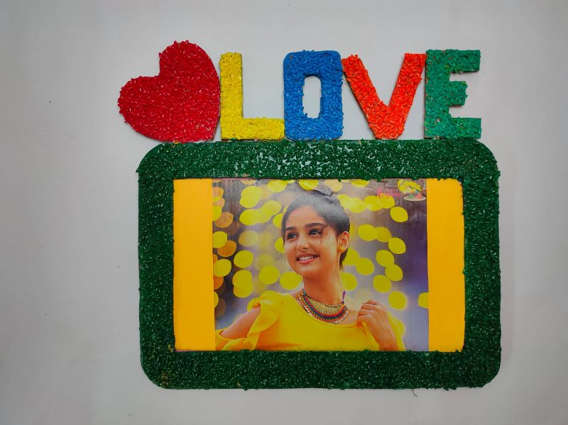 Photo frame at home with cardboard