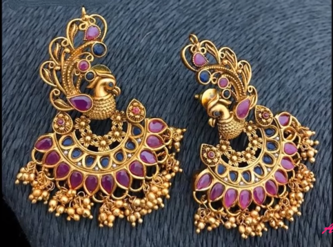 Gold peacock design earrings